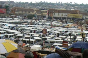 Taxi vans crammed into the taxi terminal. Vans are often loaded