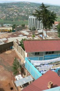 Shanties and upscale apartments near city center in Kigali.