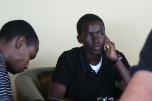 Student at trendy Internet cafe in Kigali.
