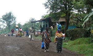 Busy village road in Marangu with colorfully clothed women.