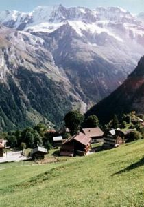Switzerland - Alpine villages and farms can be seen at