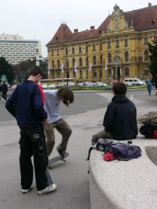 Skateboarders by the Croatian National Theatre (not seen in photo)