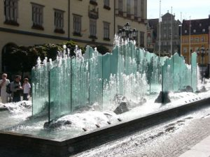 Modern glass fountain in the central