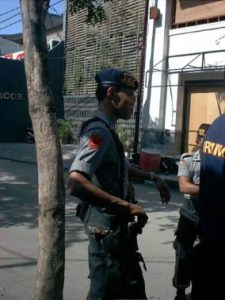 Police at the bombsite.