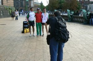 Gay journalist Michael Luongo busy taking photos of Mexican athletes.