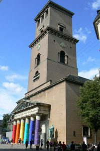 Lutheran Cathedral wrapped in gay colors during Gay Pride and