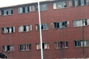 Close-up view of a derelict apartment block in a poor