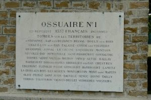 A triple ossuary is located at the back of the