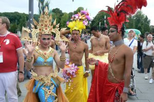 Athletes from Thailand gather outside to form the procession to