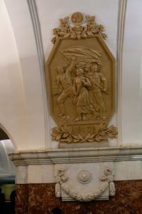 Heroic emblem in subway station.