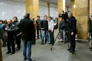 TV reporters in the subway