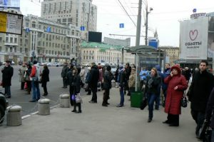 People emerging from Park Kultury station looking for alternative transportation