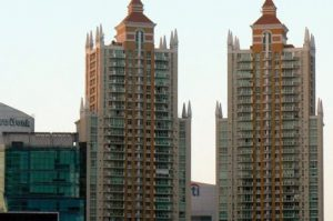 New condo towers; many are vacant and owned by foreign