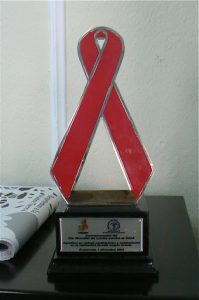 AIDS award to Oasis from the government for its education
