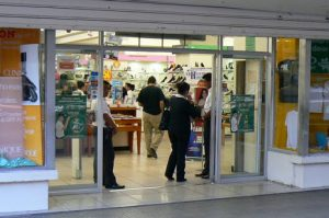 Clothing store with entry guards