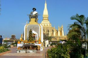 Pha That Luang national monument with statue of King Setthathirath