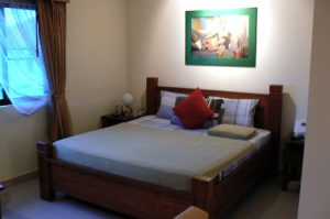 Typical bed at Sansuk Guesthouse