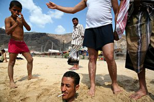 Yemen - playful friends at the beach along the Red