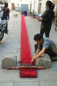 Tibet: Lhasa - Tibetan Quarter of the city;  weaver making