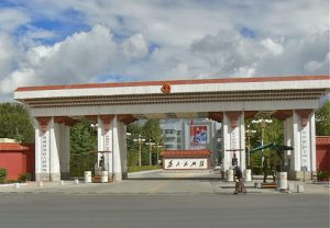 Tibet: Lhasa - entrance to the governing party headquarters; notice Chinese