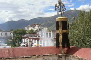 Tibet: Lhasa Distant view of Potala Palace from Jokhang Temple. Sacred juniper