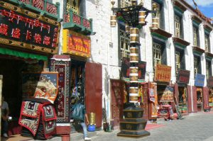 Tibet: Lhasa Outside Jokhang can be seen secular buildings and shops.