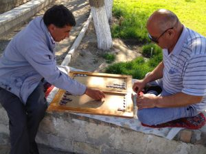 Uzbekistan: Bukhara playing bckgammon in central park; backgammon is one of the