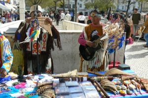 Portugal, Lisbon: Peruvian pan flute musicians playing and selling music